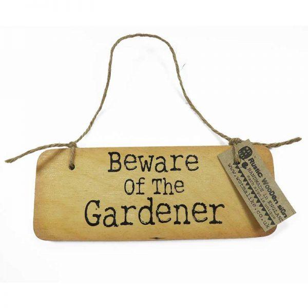 beware-of-the-garden-wooden-sign